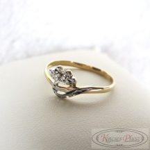 Arany gyűrű 53-as fehér arany díszítéssel